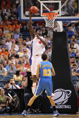 TAMPA, FL - MARCH 19:  Patric Young #4 of the Florida Gators dunks against Tyler Honeycutt #23 of the UCLA Bruins during the third round of the 2011 NCAA men's basketball tournament at St. Pete Times Forum on March 19, 2011 in Tampa, Florida.  (Photo by M
