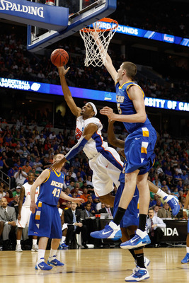 TAMPA, FL - MARCH 17:  Alex Tyus #23 of the Florida Gators drives for a shot attempt against Greg Somogyi #55 of the UC Santa Barbara Gauchos during the second round of the 2011 NCAA men's basketball tournament at St. Pete Times Forum on March 17, 2011 in