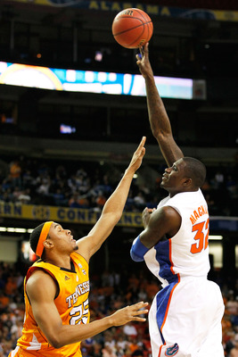 ATLANTA, GA - MARCH 11:  Vernon Macklin #32 of the Florida Gators shoots over John Fields #25 of the Tennessee Volunteers during the quarterfinals of the SEC Men's Basketball Tournament at Georgia Dome on March 11, 2011 in Atlanta, Georgia.  (Photo by Kev