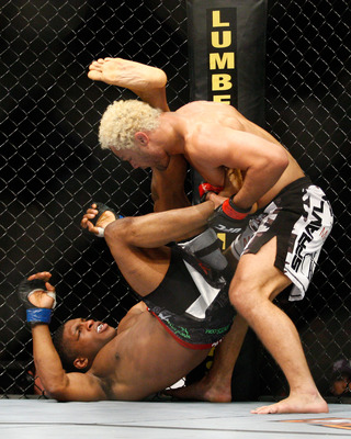 MONTREAL- MAY 8: Josh Koscheck (R) pulls the leg of Paul Daley in their welter weight bout at UFC 113 at Bell Centre on May 8, 2010 in Montreal, Quebec, Canada.  (Photo by Richard Wolowicz/Getty Images)