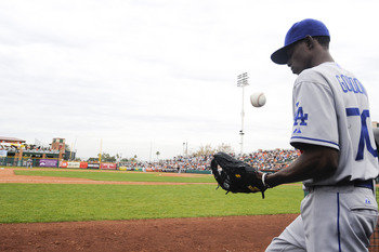 SCOTTSDALE, AZ - FEBRUARY 26: Dee Gordon #70 of the Los Angeles Dodgers tosses a ball in the dugout during a spring training game against the San Francisco Giants at Scottsdale Stadium on February 26, 2011 in Scottsdale, Arizona. (Photo by Rob Tringali/Ge