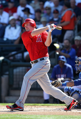 SURPRISE, AZ - MARCH 02:  Mark Trumbo #44 of the Los Angeles Angels of Anaheim bats against the Texas Rangers during the spring training game at Surprise Stadium on March 2, 2011 in Surprise, Arizona.  (Photo by Christian Petersen/Getty Images)