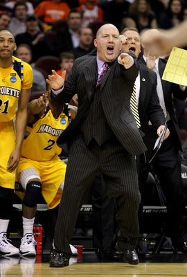 CLEVELAND, OH - MARCH 18: Head coach Buzz Williams and the Marquette Golden Eagles bench react during the first half against the Xavier Musketeers during the second round of the 2011 NCAA men's basketball tournament at Quicken Loans Arena on March 18, 201