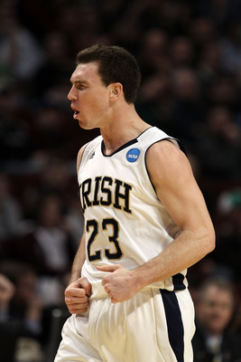 CHICAGO, IL - MARCH 18:  Ben Hansbrough #23 of the Notre Dame Fighting Irish celebrates after scoring against the Akron Zips in the first half during the second round of the 2011 NCAA men's basketball tournament at the United Center on March 18, 2011 in C