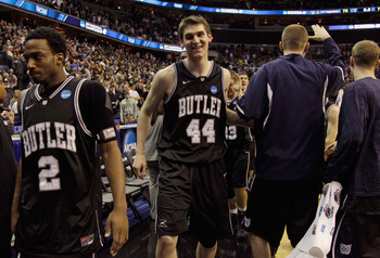 WASHINGTON - MARCH 19:  Andrew Smith #44 of Butler and teammate Shawn Vanzant #2 walk off the court after Butler's victory of Pittsburgh in the third round of the 2011 NCAA men's basketball tournament at Verizon Center on March 19, 2011 in Washington, DC.