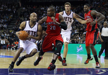 LONDON, ENGLAND - MARCH 04:  Sundiata Gaines of the Nets goes past Leandro Barbosa of the Raptors during the NBA match between New Jersey Nets and the Toronto Raptors at the O2 Arena on March 4, 2011 in London, England. NOTE TO USER: User expressly acknow