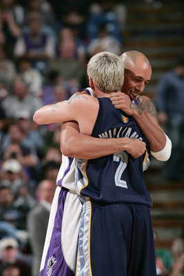 SACRAMENTO, CA - NOVEMBER 19:  Jason Williams #2 of the Memphis Gizzlies hugs Doug Christie #13 of the Sacramento Kings at Arco Arena on November 19, 2004 in Sacramento, California.  The Kings won 107-105.  NOTE TO USER: User expressly acknowledges and ag