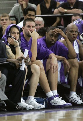 SACRAMENTO, CA - MAY 5:  (L-R) Mike Bibby #10, Brad Miller #52, Kenny Thomas #9, Bonzi Wells #42 of the Sacramento Kings sit dejected on the bench as they lose game six of the Western Conference Quarterfinals against the San Antonio Spurs during the 2006