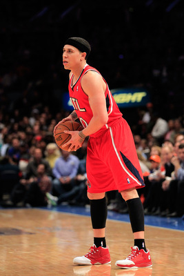 NEW YORK, NY - FEBRUARY 16:  Mike Bibby #10 of the Atlanta Hawks holds the ball on the court against the New York Knicks at Madison Square Garden on February 16, 2011 in New York City. NOTE TO USER: User expressly acknowledges and agrees that, by download