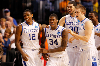 TAMPA, FL - MARCH 19:  (L-R) Brandon Knight #12, DeAndre Liggins #34, Eloy Vargas #30 and Jon Hood #4 of the Kentucky Wildcats celebrate after they won 71-63 against the West Virginia Mountaineers during the third round of the 2011 NCAA men's basketball t