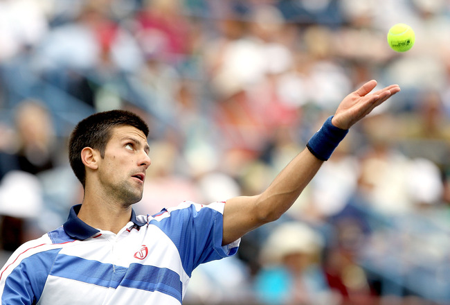 INDIAN WELLS, CA - MARCH 20:  Novak Djokovic of Serbia serves to Rafael Nadal of Spain during the final of the BNP Paribas Open at the Indian Wells Tennis Garden on March 20, 2011 in Indian Wells, California.  (Photo by Matthew Stockman/Getty Images)