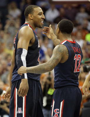 TULSA, OK - MARCH 20:  Derrick Williams #23 of the Arizona Wildcats celebrates with teammate Lamont Jones #12 after defeating the Texas Longhorns 70-69 in the third round of the 2011 NCAA men's basketball tournament at BOK Center on March 20, 2011 in Tuls