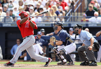 PEORIA, AZ - MARCH 15:  Torii Hunter #48 of the Los Angeles Angels of Anaheim bats against the San Diego Padres during the spring training game at Peoria Stadium on March 15, 2011 in Peoria, Arizona.  (Photo by Christian Petersen/Getty Images)