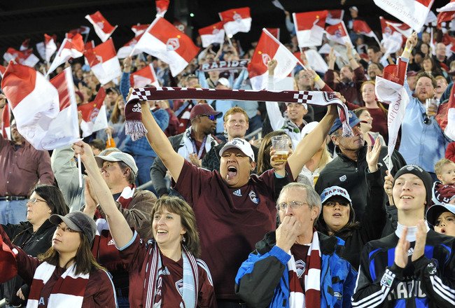 COMMERCE CITY, CO - MARCH 19: Fans of the Colorado Rapids react to a goal against the Portland Timbers on March 19, 2011 at Dicks Sporting Goods Park in Commerce City, Colorado.  (Photo by Bart Young/Getty Images)
