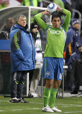 SEATTLE, WA - MARCH 15:  Head coach Sigi Schmid of the Seattle Sounders FC looks on as Leo Gonzalez #12 throws the ball in during the game against the Los Angeles Galaxy at Qwest Field on March 15, 2011 in Seattle, Washington. (Photo by Otto Greule Jr/Get
