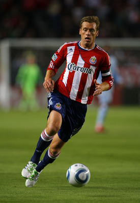 CARSON, CA - MARCH 19:  Jimmy Conrad #12 of Chivas USA runs back for the ball during the MLS match against Sporting Kansas City at The Home Depot Center on March 19, 2011 in Carson, California. SKC defeated Chivas USA 3-2.  (Photo by Victor Decolongon/Get