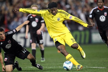WASHINGTON, D.C. - MARCH 19: Andres Mendoza #10 of the Columbus Crew shoots the ball against Jed Zayner #12 of D.C. United at RFK Stadium on March 19, 2011 in Washington, DC. (Photo by Ned Dishman/Getty Images)