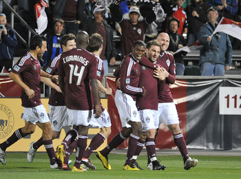 COMMERCE CITY, CO - MARCH 19: Anthony Wallace #6 and Connor Casey #9 celebrate Jamie Smith's #20 goal of the Colorado Rapids v the Portland Timbers on March 19, 2011 at Dicks Sporting Goods Park in Commerce City, Colorado.  (Photo by Bart Young/Getty Imag