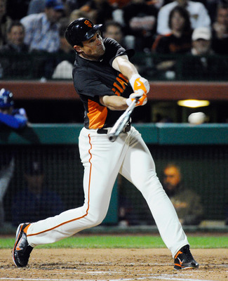 SCOTTSDALE, AZ - MARCH 07:  Pat Burrell #5 of the San Francisco Giants swings the bat during an exhibition baseball game against the Texas Rangers in the first meeting between the two teams since the World Series at Scottsdale Stadium on March 7, 2011 in