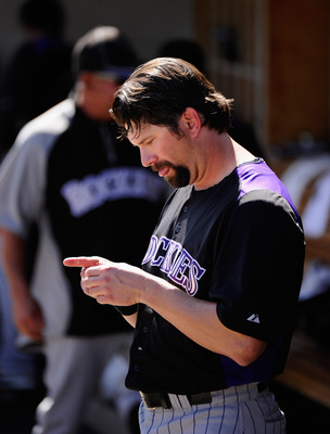 PHOENIX, AZ - MARCH 10:  Todd Helton #17 of the Colorado Rockies in the dugout against the Milwaukee Brewers during the spring training baseball game at Maryvale Baseball Park on March 10, 2011 in Phoenix, Arizona.  (Photo by Kevork Djansezian/Getty Image