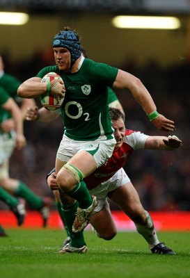 CARDIFF, WALES - MARCH 12:  Sean O'Brien of Ireland is tackled by Matthew Rees of Wales during the RBS Six Nations Championship match between Wales and Ireland at the Millennium Stadium on March 12, 2011 in Cardiff, Wales.  (Photo by Laurence Griffiths/Ge