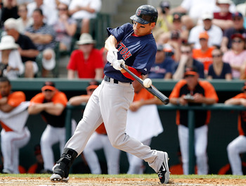 SARASOTA, FL - MARCH 05:  Outfielder Jacoby Ellsbury #2 of the Boston Red Sox fouls off a pitch against the Baltimore Orioles during a Grapefruit League Spring Training Game at Ed Smith Stadium on March 5, 2011 in Sarasota, Florida.  (Photo by J. Meric/Ge