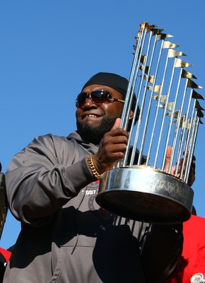BOSTON - OCTOBER 30:  David Ortiz #34 of the Boston Red Sox holds the World Series Trophy during the Boston Red Sox World Series Victory Celebration on October 30, 2007 in Boston, Massachusetts  (Photo by Elsa/Getty Images)