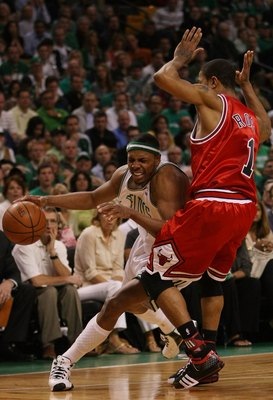 BOSTON - MAY 02:  Paul Pierce #34 of the Boston Celtics tries to get around Derrick Rose #1 of the Chicago Bulls in Game Seven of the Eastern Conference Quarterfinals during the 2009 NBA Playoffs at TD Banknorth Garden on May 2, 2009 in Boston, Massachuse