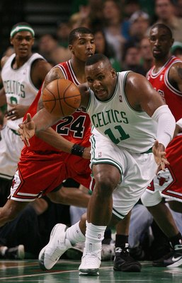 BOSTON - MAY 02:  Glen Davis #11 of the Boston Celtics loses the ball as Tyrus Thomas #24 of the Chicago Bulls defends in Game Seven of the Eastern Conference Quarterfinals during the 2009 NBA Playoffs at TD Banknorth Garden on May 2, 2009 in Boston, Mass