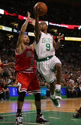 BOSTON - MAY 02:  Rajon Rondo #9 of the Boston Celtics drives past Derrick Rose #1 of the Chicago Bulls  in Game Seven of the Eastern Conference Quarterfinals during the 2009 NBA Playoffs at TD Banknorth Garden on May 2, 2009 in Boston, Massachusetts. NOT