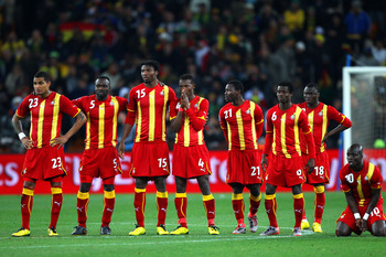 JOHANNESBURG, SOUTH AFRICA - JULY 02:  The Ghana team look on dejected during a penalty shoot out during the 2010 FIFA World Cup South Africa Quarter Final match between Uruguay and Ghana at the Soccer City stadium on July 2, 2010 in Johannesburg, South A