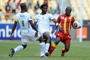 ANGOLA, LUANDA - JANUARY 19: Mahamoudou Kere, Florent Rouamba of Burkina Faso challenge Matthew Amoah of Ghana  during the Africa Cup of Nations match between Burkina Fuso and Ghana at the November 11 (Cidadela) Stadium on January 19, 2010 in Luanda, Ango