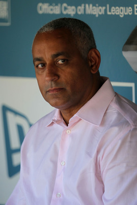 LOS ANGELES, CA - JULY 24:  New York Mets general manager Omar Minaya looks on from the dugout prior to the start of the game against the Los Angeles Dodgers at Dodger Stadium on July 24, 2010 in Los Angeles, California.  (Photo by Jeff Gross/Getty Images