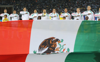 JOHANNESBURG, SOUTH AFRICA - JUNE 27: The Mexico team line up for their national anthem during the 2010 FIFA World Cup South Africa Round of Sixteen match between Argentina and Mexico at Soccer City Stadium on June 27, 2010 in Johannesburg, South Africa.