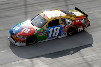BRISTOL, TN - MARCH 20:  Kyle Busch, driver of the #18 M&M's Toyota, leads the field during the NASCAR Sprint Cup Series Jeff Byrd 500 Presented By Food City at Bristol Motor Speedway on March 20, 2011 in Bristol, Tennessee.  (Photo by Jason Smith/Getty I