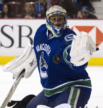 VANCOUVER, CANADA - MARCH 3: Goalie Roberto Luongo #1 of the Vancouver Canucks makes a glove save against the Nashville Predators during the first period in NHL action on March 03, 2011 at Rogers Arena in Vancouver, British Columbia, Canada.  (Photo by Ri