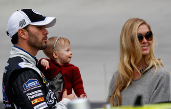 BRISTOL, TN - MARCH 20: Jimmie Johnson (L), driver of the #48 Lowe's/Kobalt Tools Chevrolet, stands on the grid with wife Chandra (R), and daughter Genevieve Marie, during the NASCAR Sprint Cup Series Jeff Byrd 500 Presented By Food City at Bristol Motor