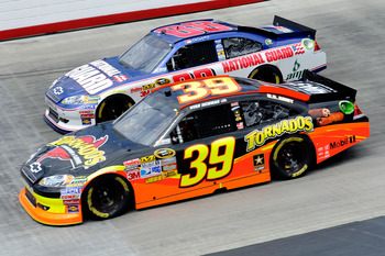 BRISTOL, TN - MARCH 20:  Ryan Newman, driver of the #39 Tornados Chevrolet, races Dale Earnhardt Jr., driver of the #88 National Guard/Amp Energy Chevrolet, during the NASCAR Sprint Cup Series Jeff Byrd 500 Presented By Food City at Bristol Motor Speedway