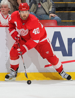 DETROIT, MI - MARCH 9:  Henrik Zetterberg #40 of the Detroit Red Wings controls the puck in a game against the Los Angeles Kings on March 9, 2011 at the Joe Louis Arena in Detroit, Michigan. The Kings defeated the Wings 2-1. (Photo by Claus Andersen/Getty