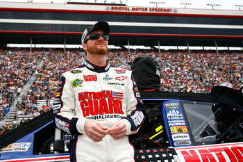 BRISTOL, TN - MARCH 20:  Dale Earnhardt Jr., stands beside the #88 AMP Energy/National Guard Chevrolet, during pre-race activities for the NASCAR Sprint Cup Series Jeff Byrd 500 Presented By Food City at Bristol Motor Speedway on March 20, 2011 in Bristol