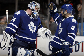 TORONTO, CANADA - MARCH 19  James Reimer #34 and Nazem Kadri #43 of the Toronto Maple Leafs celebrate 5-2 win over the Boston Bruins during game action at the Air Canada Centre March 19, 2011 in Toronto, Ontario, Canada. (Photo by Abelimages/Getty Images)