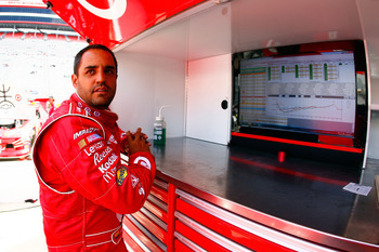 BRISTOL, TN - MARCH 19:  Juan Pablo Montoya, driver of the #42 Target Chevrolet, looks over times in the garage area during practice for the NASCAR Sprint Cup Series Jeff Byrd 500 Presented By Food City at Bristol Motor Speedway on March 19, 2011 in Brist