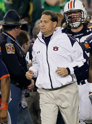 GLENDALE, AZ - JANUARY 10:  Cameron Newton #2, Head coach Gene Chizik, Lee Ziemba #73 and Kodi Burns #18 of the Auburn Tigers react on the sideline against the Oregon Ducks during the Tostitos BCS National Championship Game at University of Phoenix Stadiu