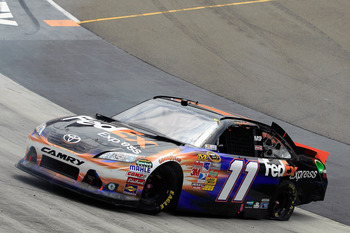 BRISTOL, TN - MARCH 20:  Denny Hamlin, driver of the #11 FedEx Express Toyota, spins out after an incident in the NASCAR Sprint Cup Series Jeff Byrd 500 Presented By Food City at Bristol Motor Speedway on March 20, 2011 in Bristol, Tennessee.  (Photo by C