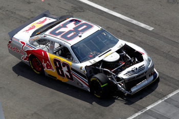 BRISTOL, TN - MARCH 20:  Brian Vickers drives the wrecked #83 Red Bull Toyota during the NASCAR Sprint Cup Series Jeff Byrd 500 Presented By Food City at Bristol Motor Speedway on March 20, 2011 in Bristol, Tennessee.  (Photo by Jeff Zelevansky/Getty Imag