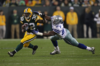 GREEN BAY, WI - NOVEMBER 07: Brandon Jackson #32 of the Green Bay Packers breaks away from DeMarcus Ware #94 of the Dallas Cowboys at Lambeau Field on November 7, 2010 in Green Bay, Wisconsin. (Photo by Jonathan Daniel/Getty Images)