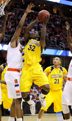 CLEVELAND, OH - MARCH 20: Jae Crowder #32 of the Marquette Golden Eagles drives to the basket against Fab Melo #51 of the Syracuse Orange during the third of the 2011 NCAA men's basketball tournament at Quicken Loans Arena on March 20, 2011 in Cleveland,