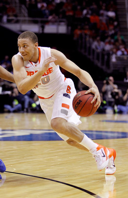 CLEVELAND, OH - MARCH 18: Brandon Triche #20 of the Syracuse Orange drives with the ball against the Indiana State Sycamores during the second round of the 2011 NCAA men's basketball tournament at Quicken Loans Arena on March 18, 2011 in Cleveland, Ohio.