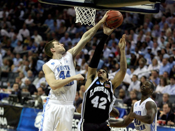 CHARLOTTE, NC - MARCH 18:  Julian Boyd #42 of the Long Island Blackbirds goes up for a shot over Tyler Zeller #44 of the North Carolina Tar Heels in the second half during the second round of the 2011 NCAA men's basketball tournament at Time Warner Cable