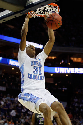 CHARLOTTE, NC - MARCH 20:  John Henson #31 of the North Carolina Tar Heels dunks the ball in the second half while taking on the Washington Huskies during the third round of the 2011 NCAA men's basketball tournament at Time Warner Cable Arena on March 20,